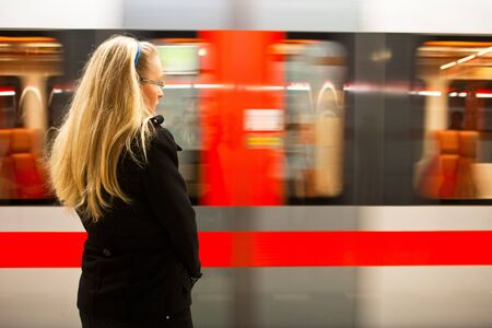 Young woman waiting for incoming trainsubway  Stock Photo
