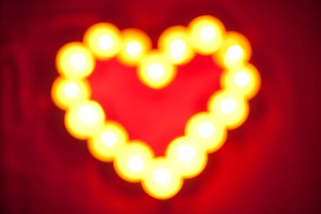 abstract heart red valentyne background made out of candles (bokeh, abstract) photo
