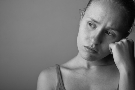 Portrait of very young depressed woman-girl black and white  Standard-Bild