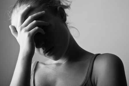Portrait of very young depressed woman-girl black and white  Stock Photo