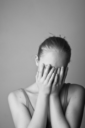 Portrait of very young depressed woman-girl black and white  photo