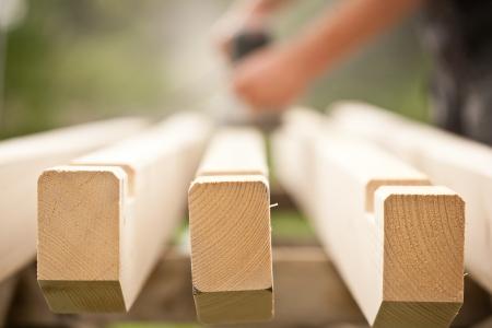 Closeup of a handyman  carpenter s hand sanding a wood with sander Stock Photo - 14618313