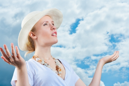Young woman complains about weather change, dark clouds and rain are coming, bad weather concept Stock Photo - 15200656