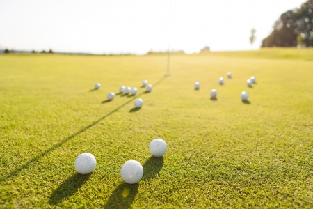 closeup shot of golf balls on green golf course Stock Photo - 15499016