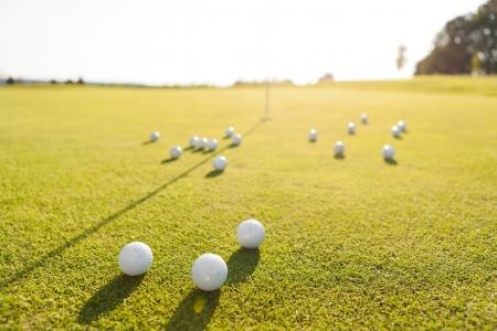 closeup shot of golf balls on green golf course Stock Photo - 15499016