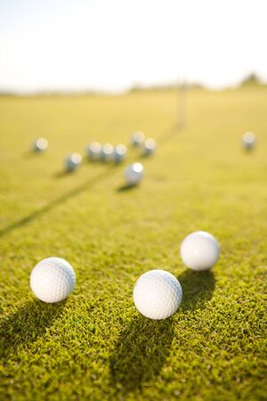excersise: closeup shot of golf balls on green golf course