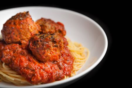 classic italian dish- spaghetti pasta with meatballs and tomato sauce on a clean, dark background Stock Photo - 18496635