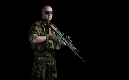 power rangers:  us army marine recon special forces seal team soldier holding an assault rifle gun on a black background, very dramatic and super sharp action image