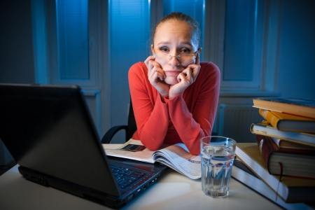 young bored female college student studying poorly at late evening before exam, funny night procrastination concept Stock Photo - 18496674