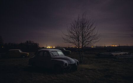 old car wreck parked at junkyard