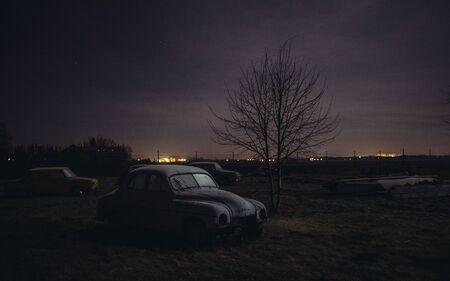 immobile: old car wreck parked at junkyard