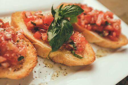 heathy diet: closeup shot of an bruschetta with tomato and basil Stock Photo