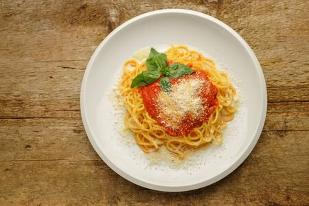 classic spaghetti al pomodoro served with parmesan cheese and fresh basil