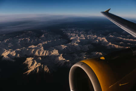 view on mountains from airplane