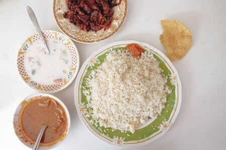 overhead shot of a typical pakistani food on white background