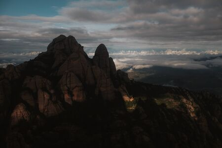 Small chapel in Montserrat mountains perfectly lit by last rays of sunset Stock Photo