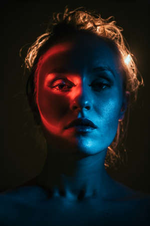 weird colourful portrait of young woman