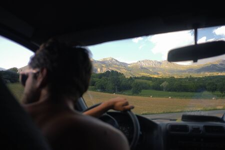 driver driving in the mountains in italy, dirver is not in focus