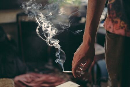 hand holding a smoking joint Stock Photo