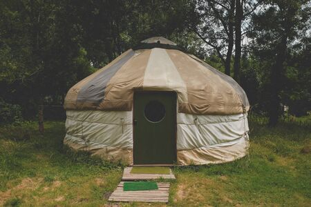 outside of a handmade yurt (tent) in the camp for people with alternative lifestyle