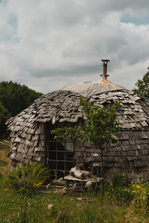 traquility: outside of a handmade yurt (tent) in the camp for people with alternative lifestyle