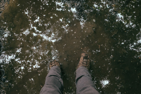point of view of a man standing in mud