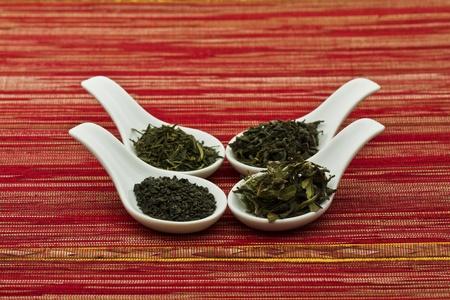 gunpowder tea: Assorted green tea in spoons Stock Photo