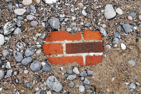 spurn: Bricks burried in Sand and Pebble