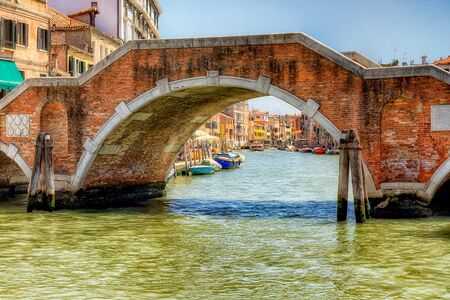 Canal view under Ponte dei Tre Archi in Venice Banque d'images