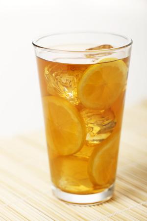 ice lemon tea: A glass of ice tea with ice and lemon