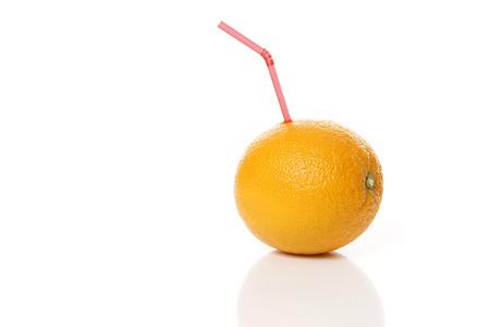 navel orange: Orange with a Straw Stock Photo