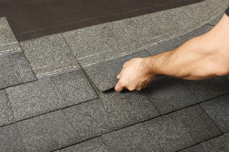 shingles: Applying roof shingles