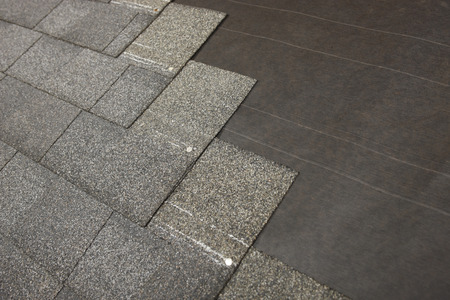asphalt shingles: A new roof during shingle application Stock Photo