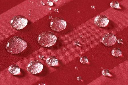 Gocce d'acqua bordato su tessuto antimacchia Archivio Fotografico - 34237797