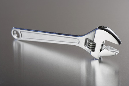 adjustable wrench: adjustable wrench with metalic background