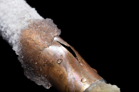 A pipe showing freeze damage Stock Photo