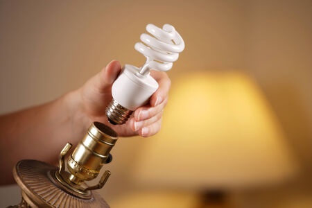 human energy: Changing a Bulb Stock Photo