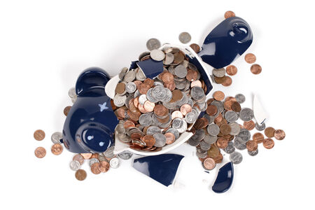 economic activity: A top view of a broken coin bank.