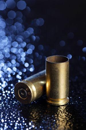 spent: Two spent 9mm bullets.