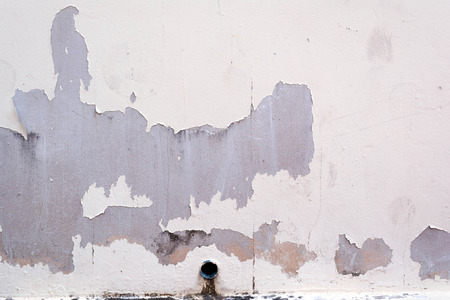 wall and pipe and peel of painted photo