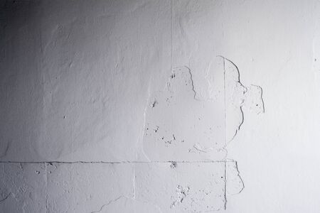 The white concrete wall peel of painted photo