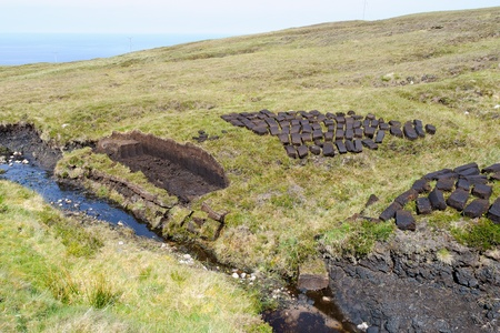 sod: Drying peat in the highlands of cape Rua Reidh, Scotland