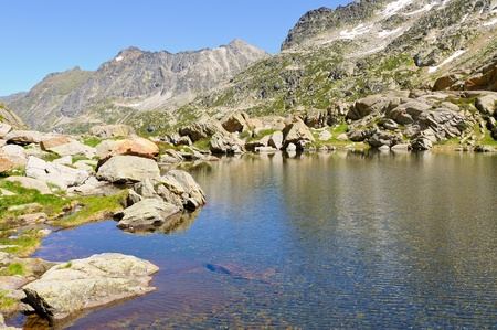 Mountain lake in Pyrenees at summer Stock Photo