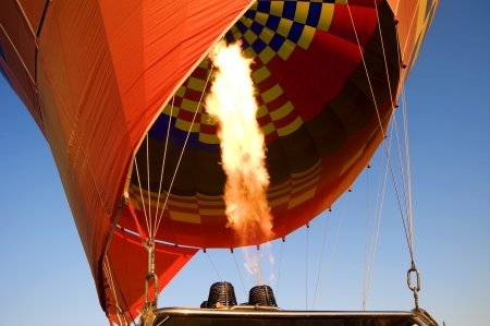 burner: Gas burning filling a hot air balloon
