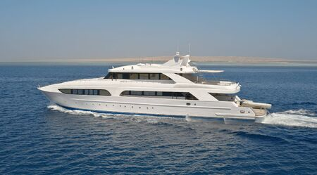 Large luxury motor yacht out at sea