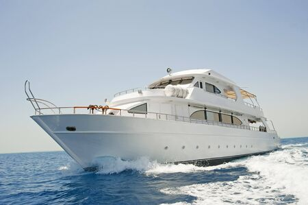 luxury yacht: A large private motor yacht under way out at sea