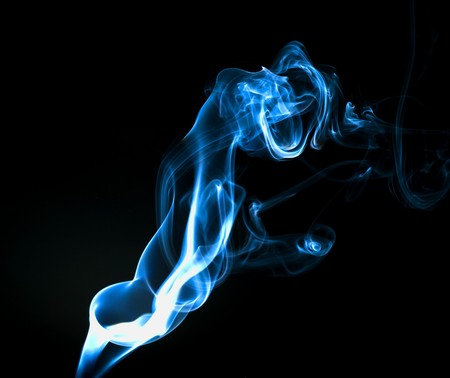 Abstract blue smoke trails on a black background