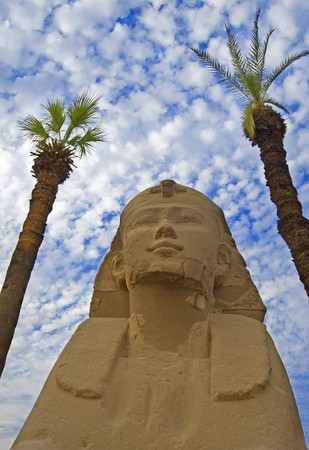 pharoah: Small sphinx at Luxor Temple framed by two trees Stock Photo