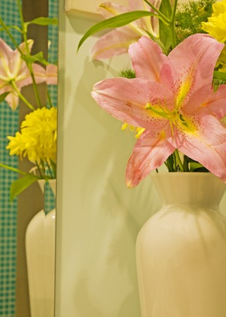 Vase full of flowers with a reflection in a mirror Stock Photo - 7318350
