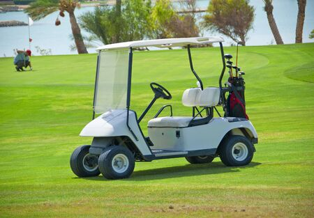 Electric golf buggy parked on the fairway of a golf course